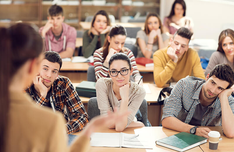Students listening to lecture in class and trying to stay focused.