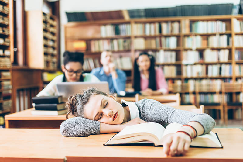 Student sleeping after studying