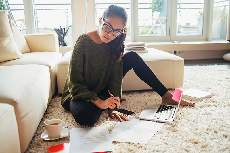 Young female studying in student house