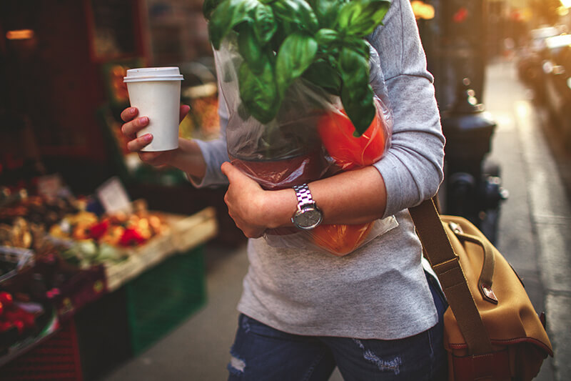 Female student carrying groceries