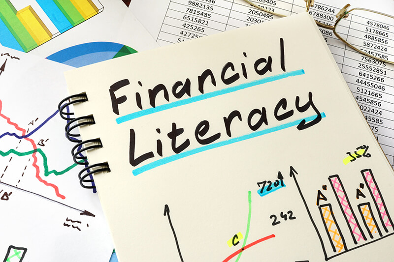 Image with title financial literacy and bar graph and line graph drawings