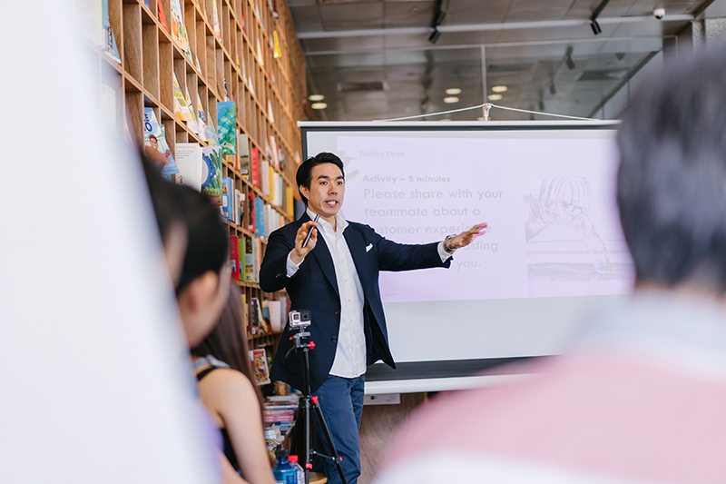 Male student presenting a speech to a group of students
