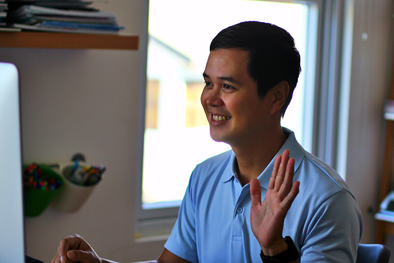 Young man participating in an online lecture