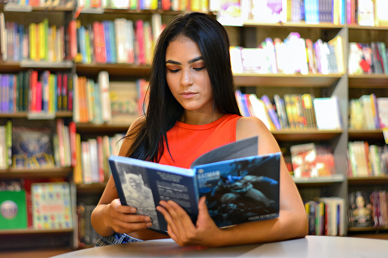 Female student researching more informative speech topics and ideas