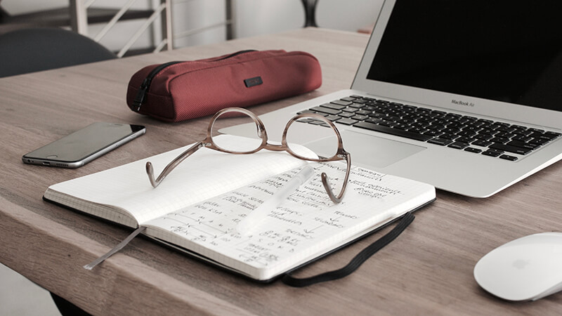 Student essay writing preparation materials on a desk