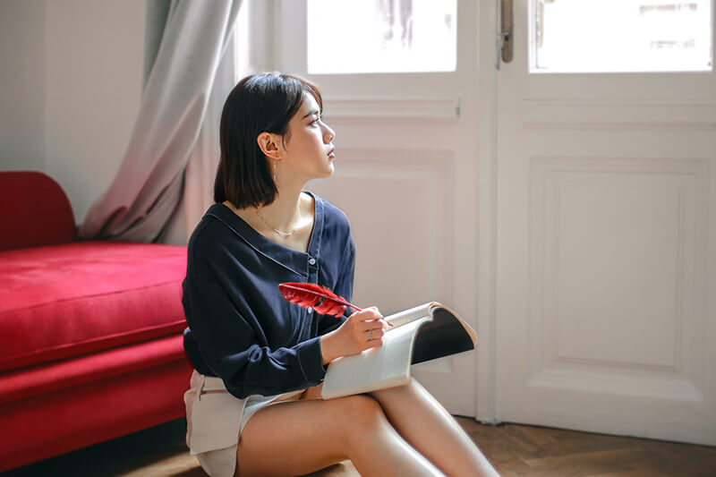 Young woman working on how to improve your writing skills