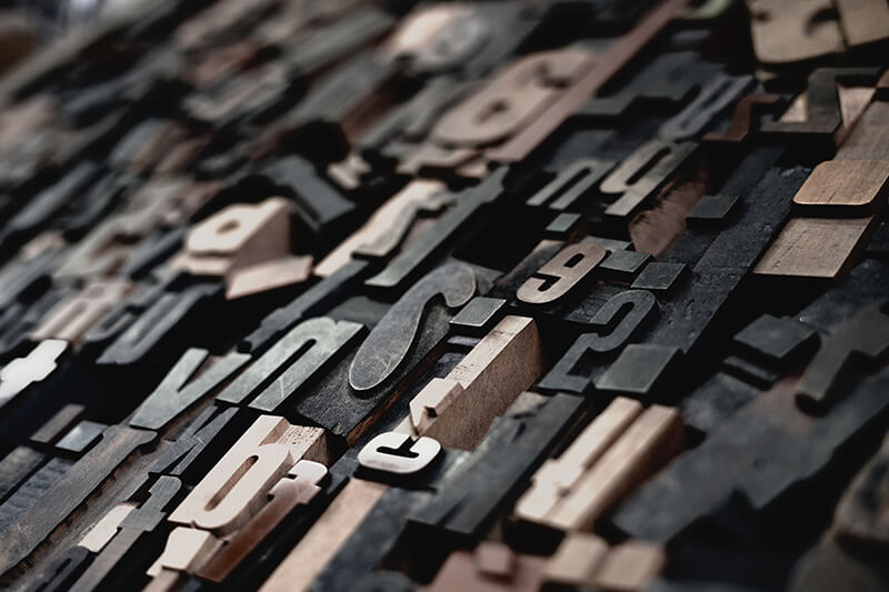 Cut out letters being used to form different sentence types