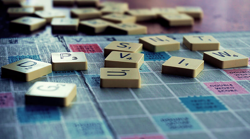 Closeup of Scrabble pieces used to create words and sentence types