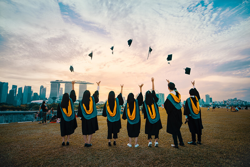 International students celebrating graduation at one of the top universities in the world