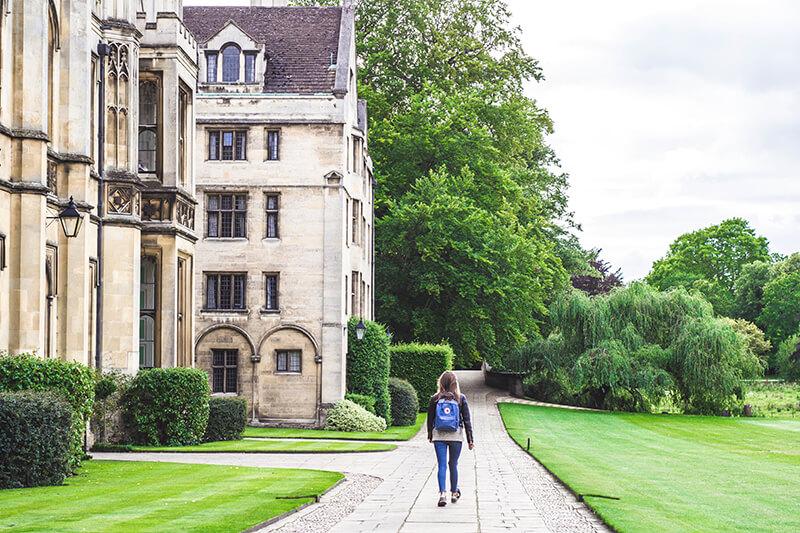 Student walking at the University of Cambridge in England, UK
