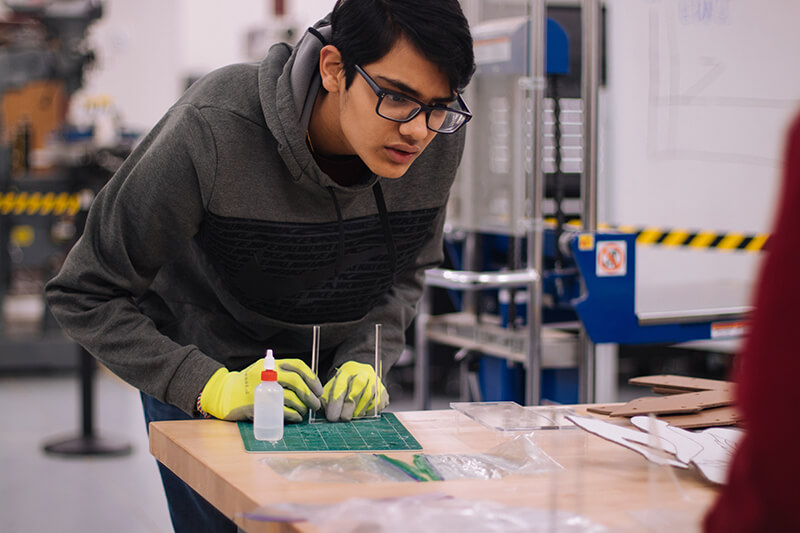 Young male scientist making an observation in a lab