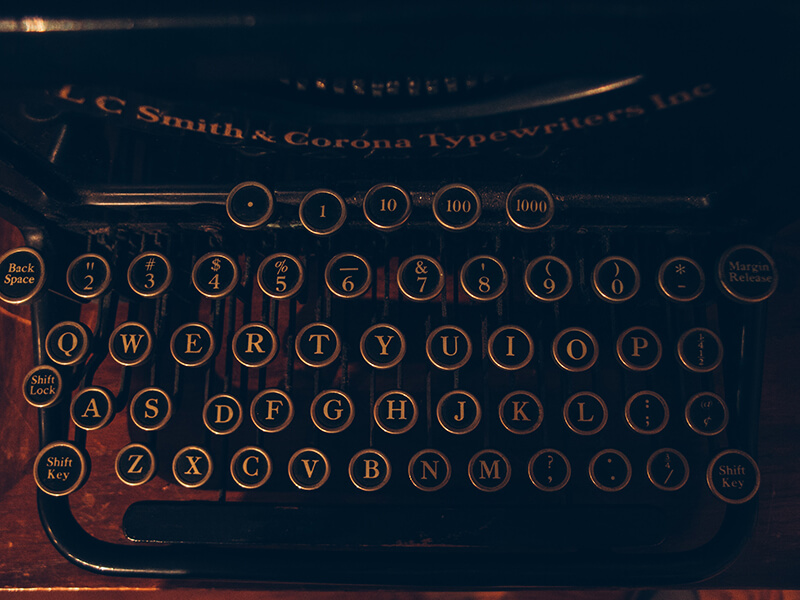 Closeup shot of a typewriter keyboard with punctuation marks on it