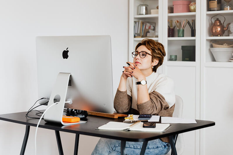 Female candidate learning how to write a follow-up email to her future employer