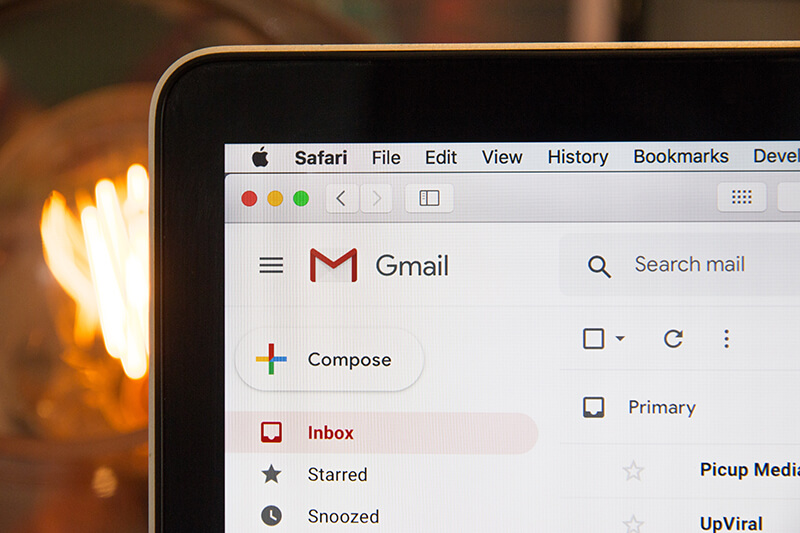 Laptop screen showing subject lines in a Gmail inbox window