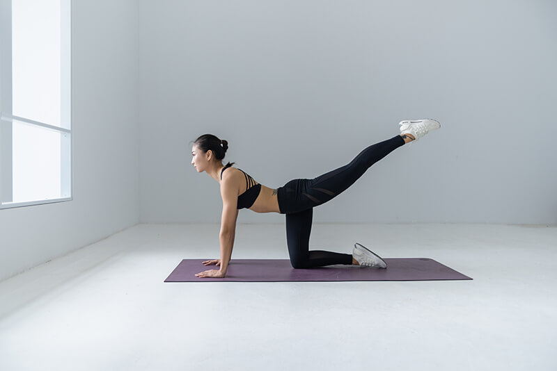 Woman doing yoga to stretch and stay healthy