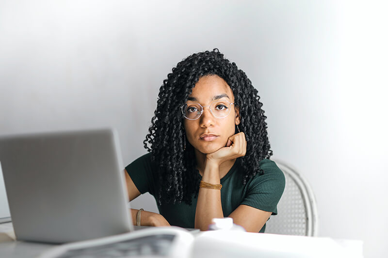 Female employee stuck while writing a professional email