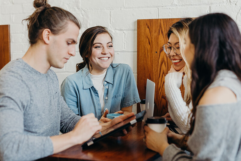 Group of students hanging out and enjoying social time within their personal life