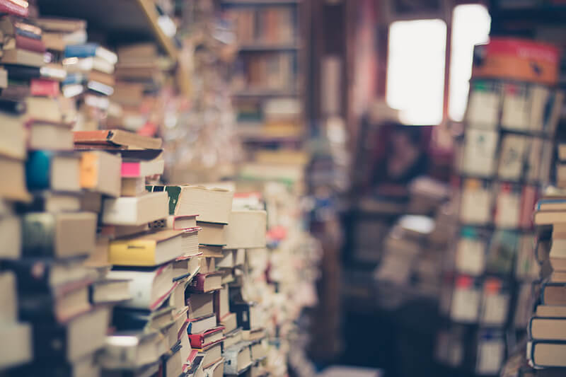 A bookstore aisle filled with books that contain literary elements