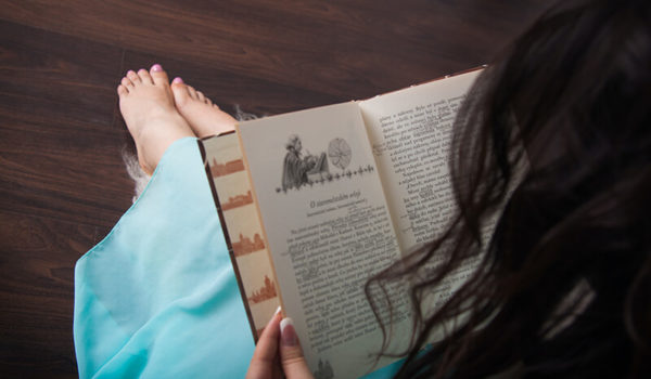 Woman reading the types of literary devices within a novel