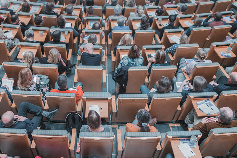 Bird's eye view of a class of students sitting in a lecture