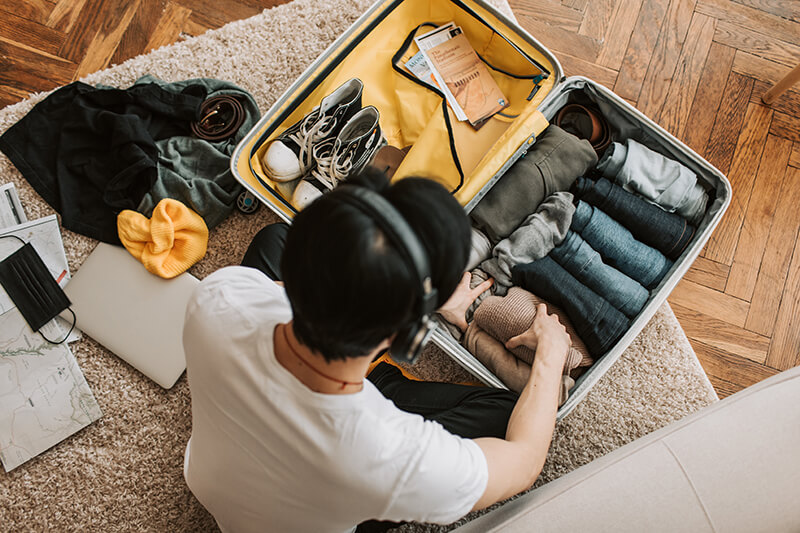 Young man getting ready for college following a college packing list