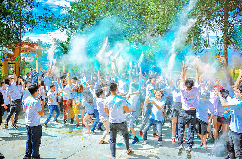 Male and female members of Greek life having a big paint party together outside